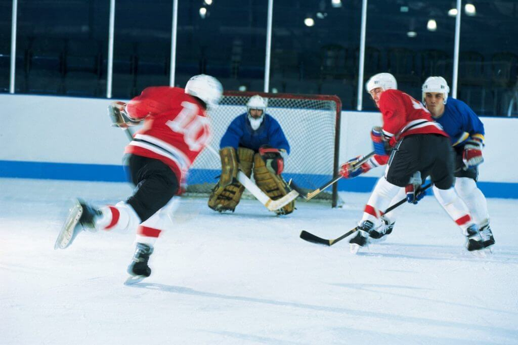 Polycarbonate barrier in hockey game